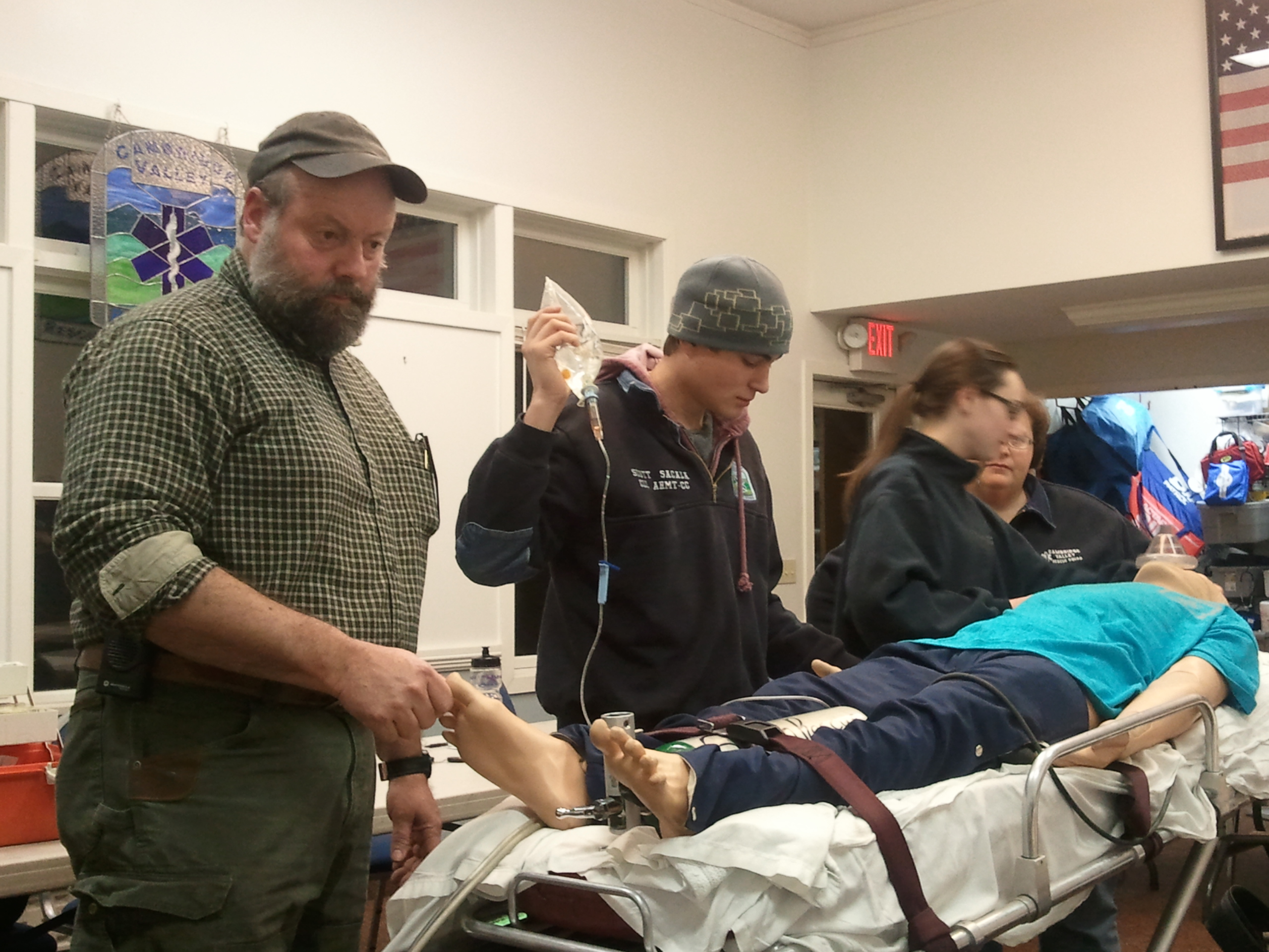 Will Moses, Scott Sacala, Jessica Sillivan and Tammi Gebo run through an ACLS scenario using the training manikin.